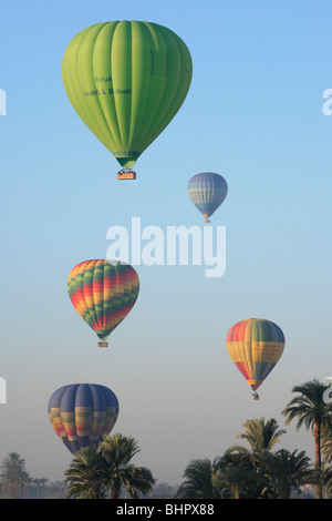 Hot air balloon flight over the West Bank of the Nile River in Luxor, Egypt - Stock Photo