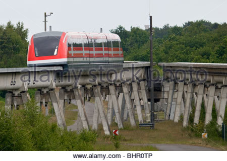 Transrapid TR09 train monorail passing junction maglev magnetic levitation transport high tech technology Lathen - Stock Photo