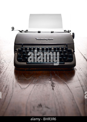 old typewriter on a wooden table - Stock Photo