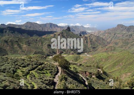 View towards Roque Bentayga near Tejeda from ridge footpath near Cruz de Tejeda (1500m) on Gran Canaria. - Stock Photo
