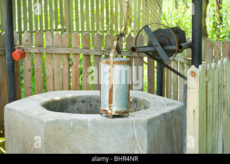 Old well with a metal bucket - Stock Photo