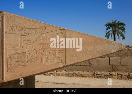 Tip of a fallen pink granite obelisk, originally erected by Queen Hatshepsut at Karnak Temple in Luxor, Egypt - Stock Photo