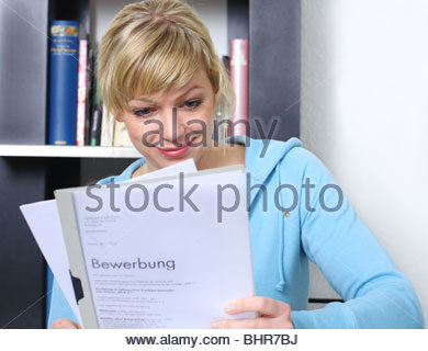 woman reading paper - Stock Photo