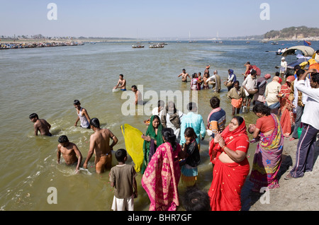Pilgrims bathing in the confluence of the Ganges and Yamuna rivers (Sangam). Allahabad. India - Stock Photo