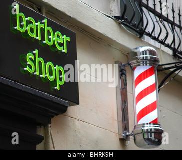 A barber shop sign in a U.K. city. - Stock Photo