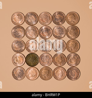 Bad Penny on Light Brown Background - Stock Photo