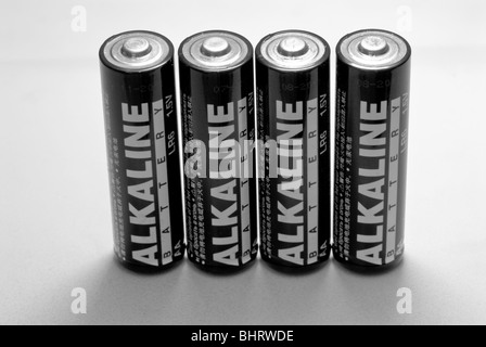 Four generic AA alkaline non rechargeable 1.5V batteries. - Stock Photo