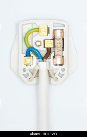 A plug showing the wiring inside - Stock Photo
