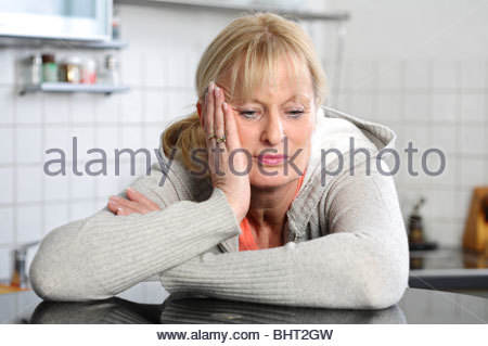 middle aged woman thinking about problems - Stock Photo