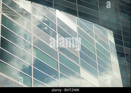 Reflections of clouds in office windows - Stock Photo