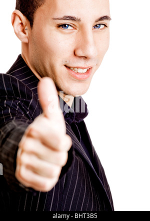Portrait of a young businessman showing thumbs up, isolated on white background - Stock Photo