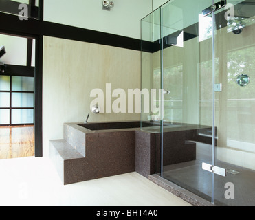 More similar stock images of Step up to large bath and shower in modern  white bathroom with extendable mirror and wall mounted chrome radiator. Step Up To Large Bath And Shower In Modern White Bathroom With