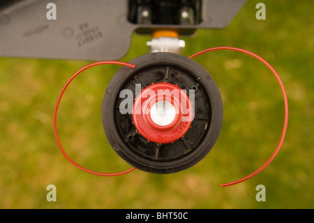 Close up of a garden strimmer/string trimmer cutting head - Stock Photo