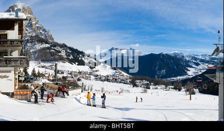 Panoramic view over the resort of Colfosco with Corvara in the distance, Sella Ronda Ski Area, Alta Badia, Dolomites, - Stock Photo