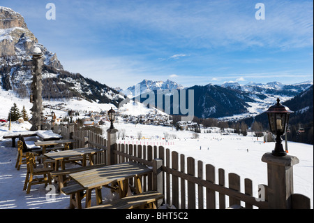 Hotel terrce with a view over the resort of Colfosco with Corvara in the distance, Sella Ronda Ski Area, Dolomites, - Stock Photo