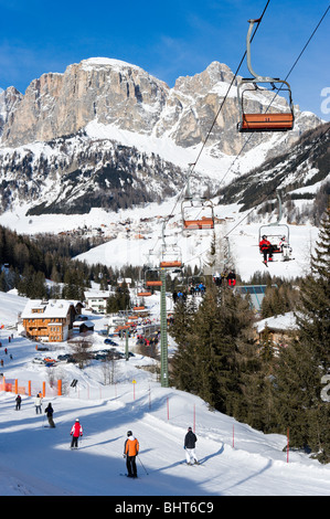 Chairlift in the resort of Corvara with Colfosco in the distance, Sella Ronda Ski Area, Alta Badia, Dolomites, Italy - Stock Photo