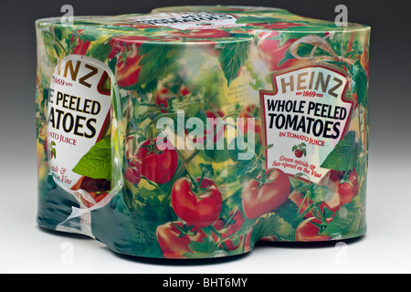 Four cans of shrink plastic cellophane wrapped Heinz whole peeled tomatoes - Stock Photo