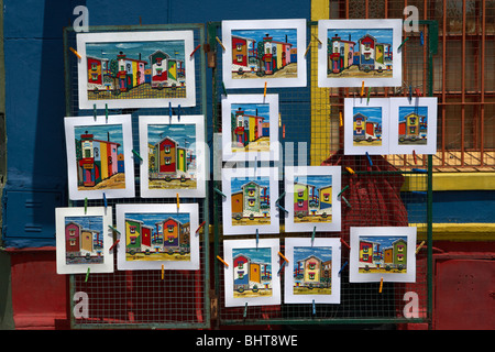 paintings on sale in street market of colourful buildings in caminito street la boca capital federal buenos aires - Stock Photo