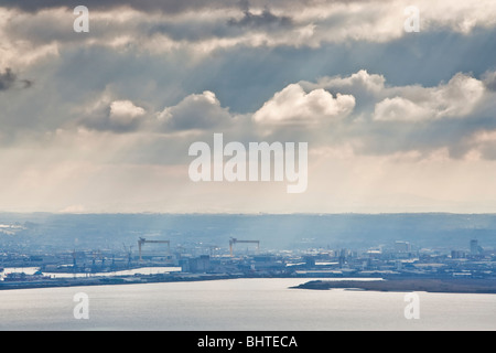 View across Belfast Lough toward the city from the summit of Knockagh in County Antrim, Northern Ireland - Stock Photo