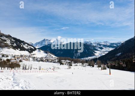 View over the resort of Colfosco with Corvara in the distance, Sella Ronda Ski Area, Alta Badia, Dolomites, Italy - Stock Photo