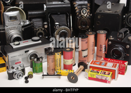 Vintage film of many different formats and makes (Kodak, Agfa and others) along with cameras it was found in (Brownie, - Stock Photo