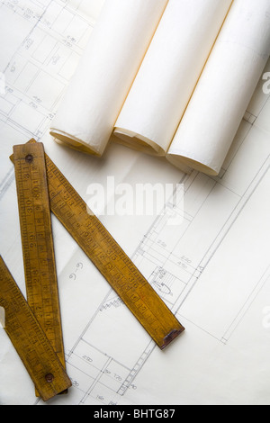 architecture plans and a carpenter's meter - Stock Photo