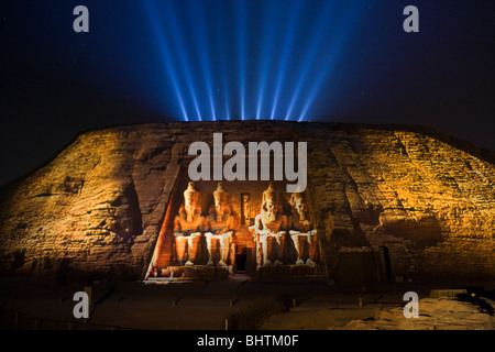 Floodlit carved statues of Ramses II Guarding the great temple of Abu Simbel at the sound and light show in Egypt. - Stock Photo