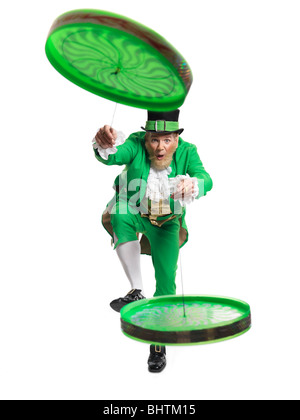 Cheerful Leprechaun playing with two flip n flyers isolated on white background - Stock Photo