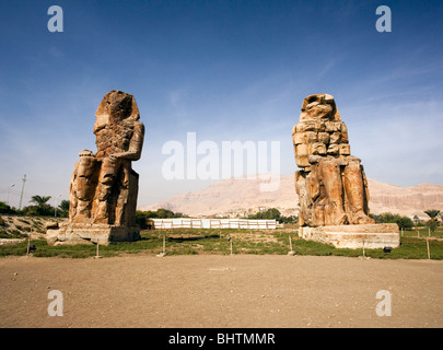 Colossi of Memnon Statues on the West Bank in Luxor, Egypt. - Stock Photo
