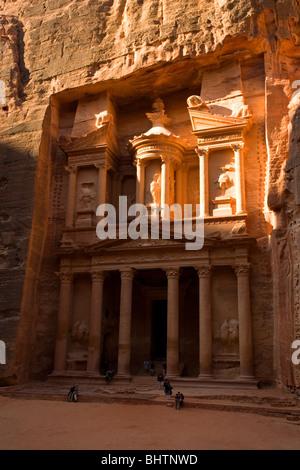 The Treasury or Al Khaznah at the ancient red rose city of Petra in Wadi Musa, Jordan. - Stock Photo