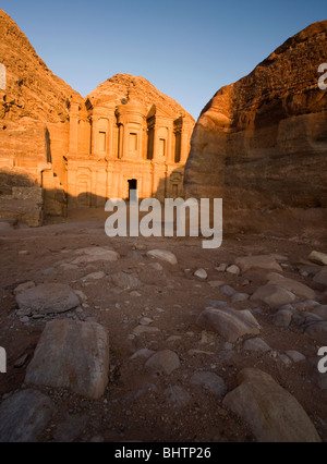 The monastery or El Deir at the ancient red rose city of Petra at sunset in Wadi Musa, Jordan. - Stock Photo