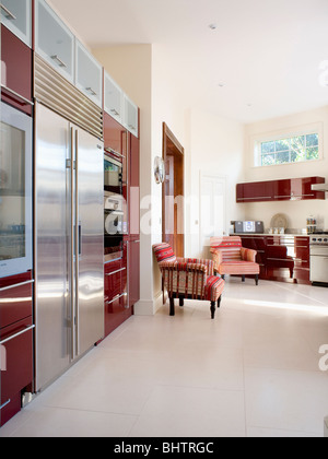 Cream flooring in large modern country kitchen with stainless steel fridge freezer