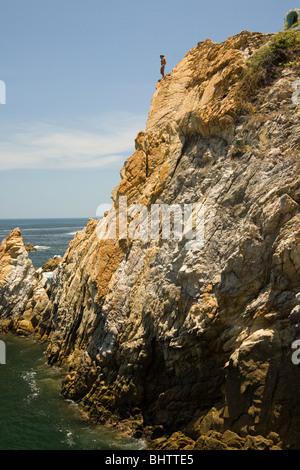 Cliff diver ready to jump, La Quebrada, Acapulco, Mexico - Stock Photo