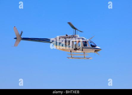Bell 206B JetRanger helicopter in flight - Stock Photo