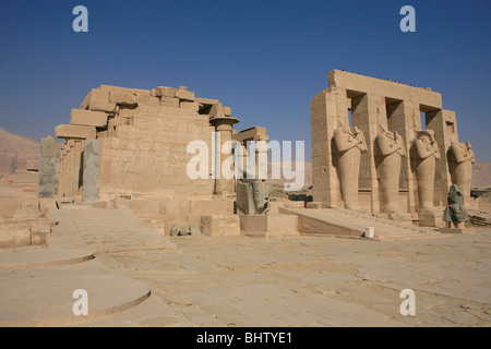 Osirid statues and granite head of Ramesses the Great at the Ramesseum in Luxor, Egypt - Stock Photo