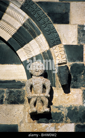 Carved Figure with Scroll, Church of San Michele de Murato (1280), Pisan Romanesque Sculpture or Carving, Corsica, - Stock Photo