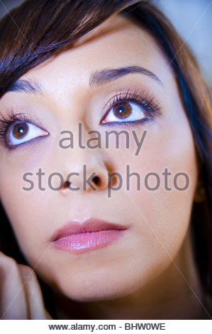 A young woman during make-up session - Stock Photo