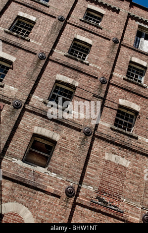 Ruins of a large industrial brick building with broken windows etc. Great background / texture - Stock Photo