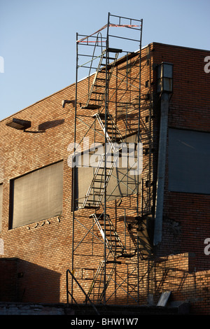 unsafe metal fire escape staircase on the side of a building in south america - Stock Photo