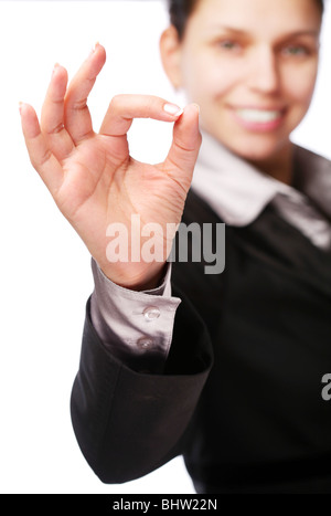 Business woman makes sign 'Ok' by hand. Isolated on a white - Stock Photo