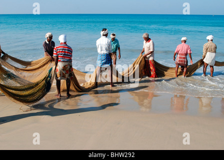 fishermen cathing fish in a beach in kerala ; india - Stock Photo
