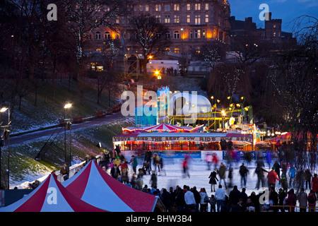 Christmas Ice rink with fun fair, Edinburgh, Princes Street gardens Scotland, UK, Europe