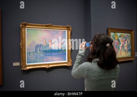 Paris, France - Woman Taking photos of French Post-Impressionist Painting, Inside of Orsay Museum, Musee d'orsay - Stock Photo