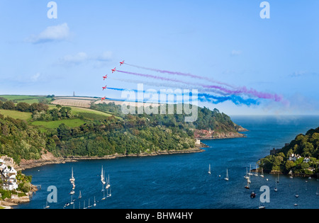 England Devon Kingswear Royal Air Force Red Arrows aerobatic display at Dartmouth Regatta - Stock Photo