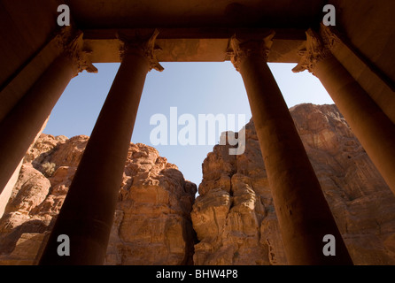 View of columns from inside the Treasury or Al Khaznah looking towards the Al Siq canyon in the ancient city of - Stock Photo