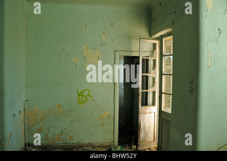 a weathered door and messy room of an abandoned house in. Black Bedroom Furniture Sets. Home Design Ideas