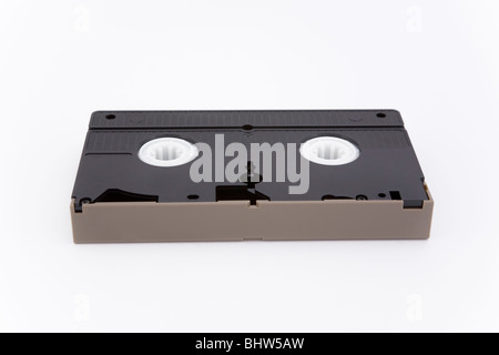 Old VHS video tape cassette white background record recording technology ancient useless innovation past superannuated - Stock Photo