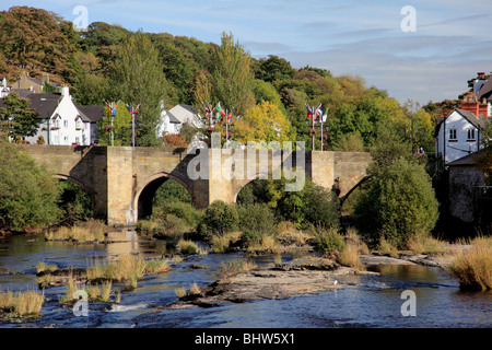 The bridge over the river Dee at Llangollen, Wales with the flags of many nations flying during the International - Stock Photo
