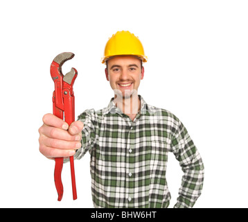 confident manual worker holding a big red wrench isolated on white - Stock Photo