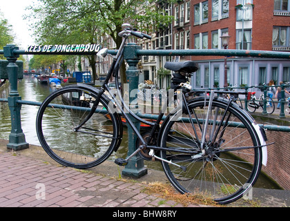 Bicycle on a canal bridge, Amsterdam, Holland - Stock Photo